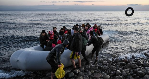 Refugees and migrants land ashore the Greek island of Lesbos on Monday. Photograph: Aris Messinis/AFP via Getty Images