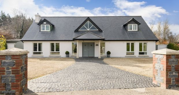 Number 5 Finnstown Fairways, Lucan, Co Dublin, has two living rooms, one formal room that opens to the dining space in the garden, and a smaller one used as a music room.