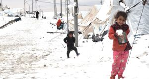 Children play in the snow at Bardarash refugee camp. Photograph: Lorraine Mallinder