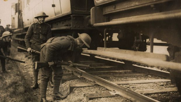 British soldiers of the Loyal North Lancashire Regiment search a train in Co Kerry. Photograph courtesy of the National Library of Ireland