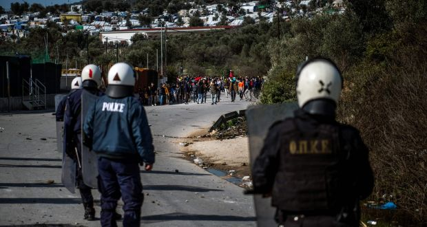 Migrants and refugees block a road near the Moria camp  during clashes with riot police on the island of Lesbos on Monday. Photograph:  Angelos Tzortzinis/AFP via Getty Images