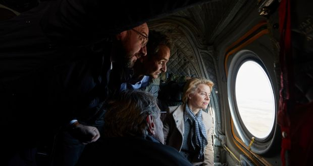 European Council president Charles Michel (left), European Parliament president David Sassoli (back to camera), Greek prime minister Kyriákos Mitsotákis and European Commission president Ursula von der Leyen  look out of the window of a helicopter during a flight over Evros, at the Greek-Turkish border in northern Greece, on Tuesday. Photograph: Dimitris Papamitsos/EPA/Greek prime minister's office