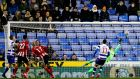 Sheffield United's  David McGoldrick heads home to score the opening goal in the FA Cup fifth-round  match against Reading at the Madejski stadium. Photograph: Adrian Dennis/AFP via Getty Images
