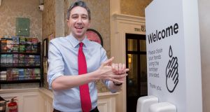 Minister for Health Simon Harris using a hand sanitiser at Buswells Hotel, Dublin. Photograph: Gareth Chaney/Collins