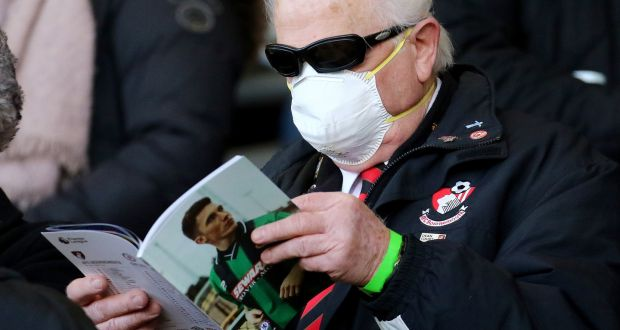 A Bournemouth fan wearing a protective mask in the stands ahead of last vweek's Premier League clash with Southampton. Photo: Mark Kerton/PA Wire