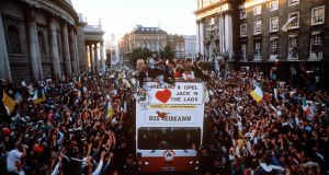 The Irish team in an open-top bus are welcomed by the crowds in Dublin on their return from the 1990 World Cup in Italy. Photograph: Inpho