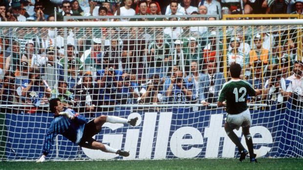 David O'Leary scores the winning penalty in the shoot-out against Romania at the 1990 World Cup in Genoa. Photograph: Bob Thomas Sports Photography via Getty Images