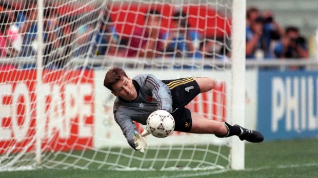 Republic of Ireland goalkeeper Packie Bonner saves a penalty during the shoot-out against Romania at the 1990 World Cup. Photograph: Billy Stickland/Inpho
