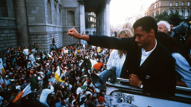 Paul McGrath waves to the crowds outside the GPO on O'Connell Street in Dublin after the Irish team returned from the 1990 World Cup in Italy. Photograph: Inpho