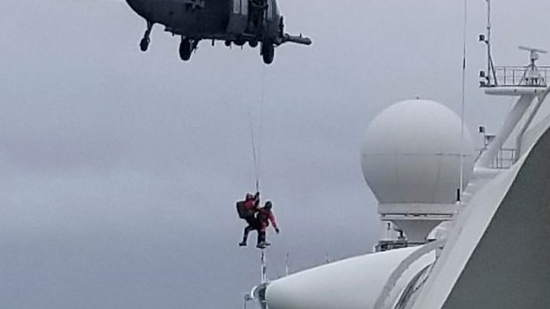 Coast Guard helicopter delivering virus testing kits lowers crew down to the Grand Princess cruise ship on Thursday. Photograph: Michele Smith/AP