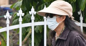 A woman wearing a face mask in Monterey Park, California. Photograph:  Frederic J Brown/AFP/Getty Images