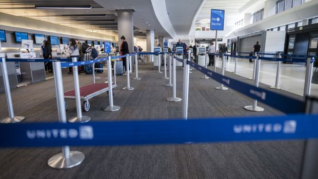 An empty check in area at the United Airlines Holdings Inc domestic check-in area at San Francisco International Airport in San Francisco on Thursday. Photographer: David Paul Morris/Bloomberg