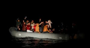 Migrants wave and shout for help following a failed attempt  to cross to the Greek island of Lesbos. Photograph: Reuters/Umit Bektas