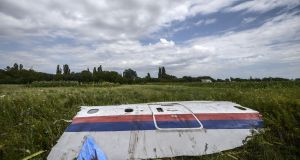 A  piece of the wreckage of Malaysia Airlines flight MH17  in a field in Donetsk: the jet flying from Amsterdam to Kuala Lumpur on July 17th, 2014, was blown out of the sky.  Photograph: Bulent Kilic/AFP