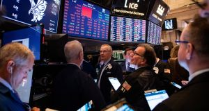 US stocks dropped on Friday, despite a strong US jobs report, extending the S&P 500's losses for the week to nearly 4 per cent in early New York trading. Photograph: Jeenah Moon/ New York Times