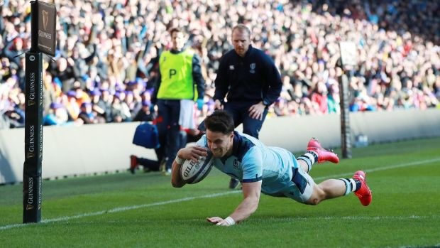 Sean Maitland dives to score Scotland's first try at Murrayfield. Photograph: David Rogers/Getty