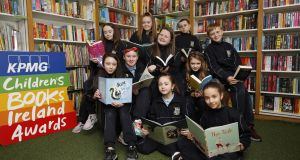 The 10 titles shortlisted for this year's KPMG Children's Books Ireland Awards  with students from St Audeon's National School, Dublin. Photograph: Leon Farrell/Photocall Ireland