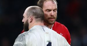 England's Joe Marler and Alun Wyn Jones of Wales after the game at Twickenham. Photograph: James Crombie/Inpho
