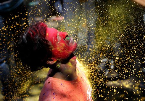 GOLD DUST: Coloured powder is tossed over participants during Holi festival celebrations in Kolkata, India, on Monday. Holi is an ancient Indian festival also known as the Festival of Colour, held to mark the arrival of spring. Photograph: Piyal Adhikary/EPA