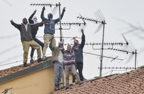 ROOFTOP PROTEST: Detainees protest on the roof of San Vittore prison in Milan, northern Italy. Violent protests broke out in Italian prisons against restrictions against the novel coronavirus, with many inmates asking for an amnesty due to the viral crisis. Photograph: Andrea Fasani/EPA