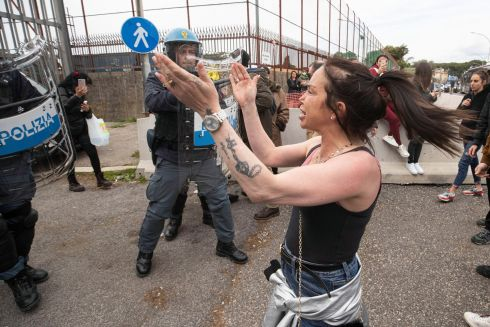 PRISON UNREST: Relatives of inmates face off against police in riot gear outside Rebibbia prison, Rome, Italy, after violence broke out there over coronavirus-related restrictions. Photograph: Massimo Percossi/EPA