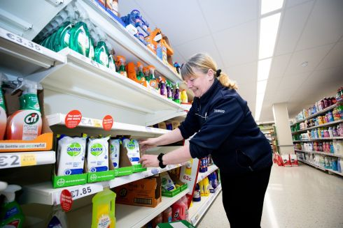 CLEANING UP: Worker Marie Downey stocks shelves with disinfectant wipes at the Tesco Superstore, Stillorgan Shopping Centre, Stillorgan, Co Dublin. Photograph: Tom Honan