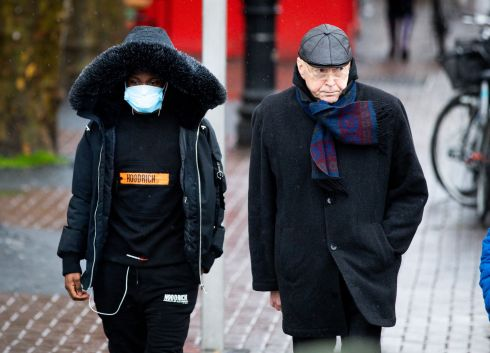 MASKED OFF: A pedestrian wears a mask against the spread of coronavirus in Dublin city centre. Photograph: Tom Honan