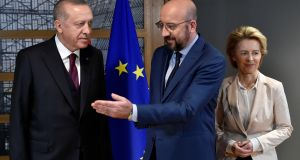 EU Council president Charles Michel (centre) and European Commission president Ursula von der Leyen (right) welcome Turkish president Tayyip Erdogan (left) before their meeting at the EU headquarters in Brussels, Belgium on Monday. Photograph: John Thys/Pool via Reuters