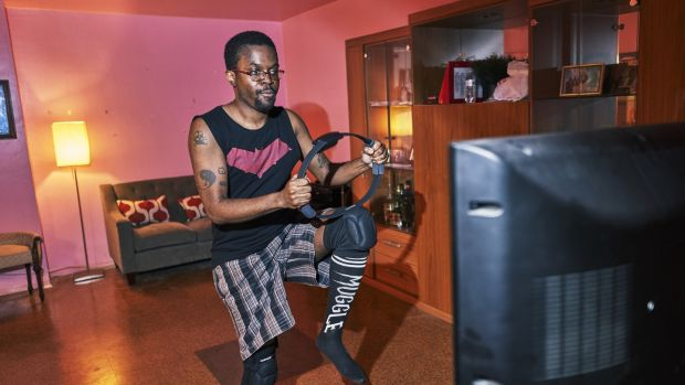 Tristan Scatliffe exercising with Ring Fit at his Brooklyn home. Ring Fit Adventure is the latest effort by the video game industry to try to entice consumers to get up off the couch and become more active. Photograph: An Rong Xu/The New York Times