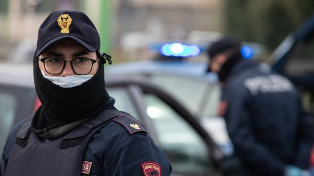 A police officer looks on at a checkpoint in Milan. The Italian Government has imposed a nationwide lockdown, limiting people to move only for work or health reasons, in an effort to fight the coronavirus outbreak. Photograph: Emanuele Cremaschi/Getty Images