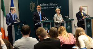 Taoiseach Leo Varadkar with Cabinet colleagues Simon Harris and Heather Humphreys, as well as Tony Holohan, chief medical officer, following the meeting of the Cabinet sub-committee on Covid-19. Photograph: Dara Mac Dónaill / The Irish Times