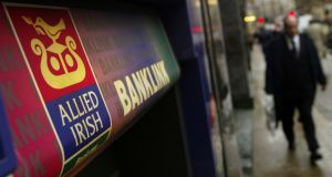 Taking cash out from an ATM costs AIB customers 35 cent per transaction. Photograph: Sion Touhig/Getty Images