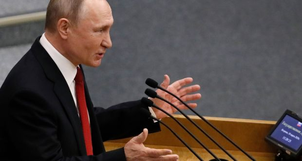 Russian president Vladimir Putin speaks during a plenary session of the State Duma  in Moscow, Russia, on Tuesday. Photograph: Yuri Kochetkov/EPA
