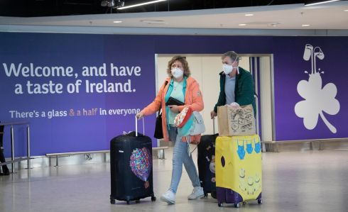 WELCOME HOME: Passengers wearing face masks arrive at Dublin Airport after disembarking flights. Photograph: Colin Keegan/Collins Dublin