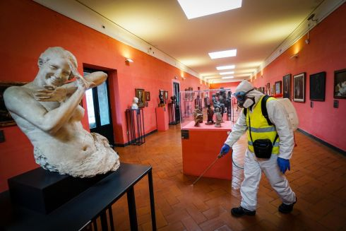 IN HAPPIER TIMES: Specialised staff wearing protective gear carry out the cleaning and sanitisation of the rooms and art pieces of the Maschio Angioino castle in Naples, Italy. Photograph: Cesare Abbate/EPA