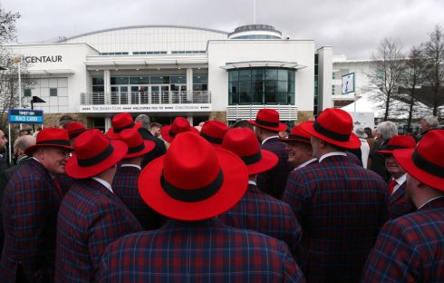 AND THEY'RE OFF: Racegoers wait for the gates to open on day one of the Cheltenham Festival. Photograph: Simon Cooper/PA Wire