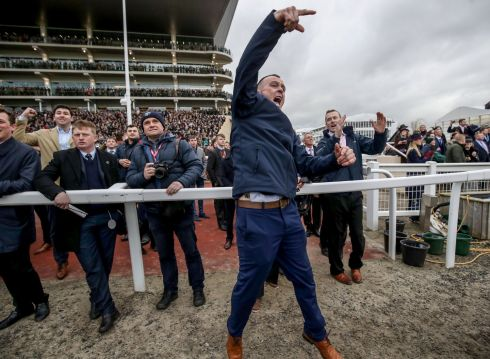 GET IN! Stable hand Stephen Dunphy celebrates Rachael Blackmore winning the Close Brothers Mares' Hurdle with Honeysuckle at Cheltenham. Photograph: Dan Sheridan/Inpho