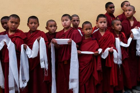 THE NEXT GENERATION: Tibetan novice Buddhist monks take part in a prayer procession at a monastery in Kathmandu, Nepal, on the 61st anniversary of the 1959 Tibetan uprising. Photograph: Prakash Mathema/AFP via Getty Images