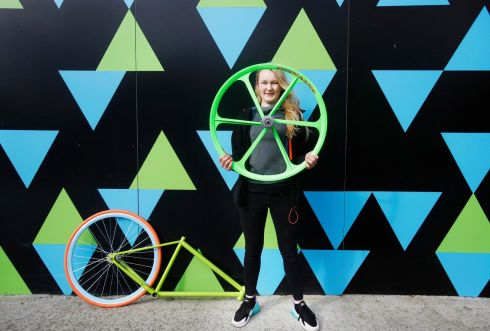 WHEEL OF FORTUNE: Master bicycle mechanic Jodie Cleary (19) from Inchicore before the launch of Irish Youth Foundation's flagship fund of €500,000 that will focus on education, wellbeing and employability. Jodie attended the Core Youth Project in Inchicore as a teenager and it was there she learned the skills to fix and repair bicycles. Photograph: Leon Farrell/Photocall Ireland