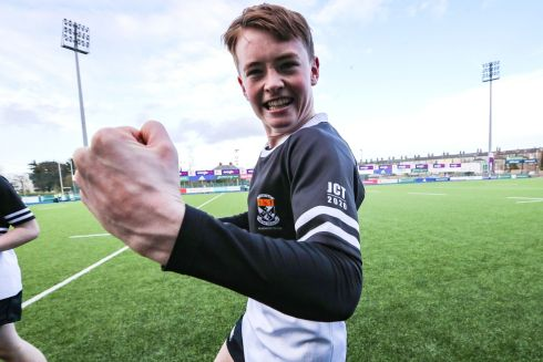DOUBLE SUCCESS: Newbridge's Tadhg Brophy celebrates after defeating Terenure in the Leinster Schools Junior Cup semi-final, at Energia Park, Donnybrook. Their senior side also made the schools cup final. Photograph: Bryan Keane/Inpho