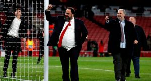 Olympiakos' president Evangelos Marinakis – who has since tested positive for coronavirus – met a number of Arsenal players after the Europa League clash last week. Photo: Adrian Dennis/AFP via Getty Images