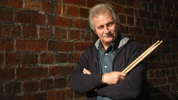 Pete Best holds drumsticks after attending a press conference at Her Majesty's Theatre to commemorate the 40th year anniversary of the only Beatles tour in Australia on June 15th, 2004 in Melbourne, Australia. Photograph: Regis Martin/Getty Images