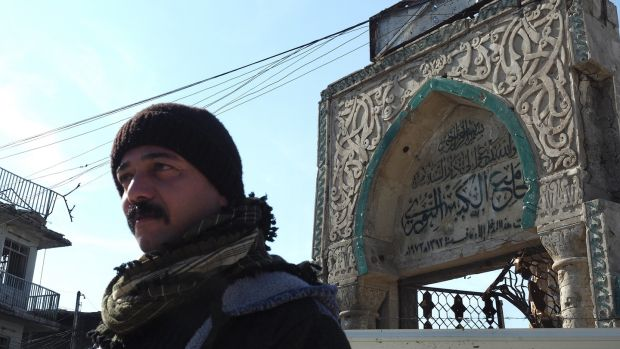Ahmed Khelil by the Great Mosque of Al-Nuri, where IS chief Abu Bakr al-Baghdadi announced the caliphate. When IS blew up the mosque in the 2017 Battle of Mosul, it was seen as gesture of defeat. Now being rebuilt with international aid. Photograph: Lorraine Mallinder