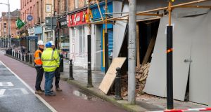 City Council engineers pictured on Washington Street in Cork city which closed off amid concerns about the structure of a building, following a partial collapse overnight. Photograph:  Daragh Mc Sweeney/Provision