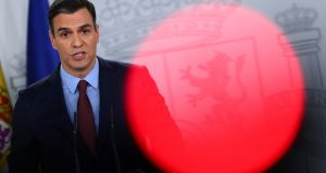 Spanish prime minister Pedro Sanchez speaks during a news conference on Tuesday: he said  the economic impact of the virus will be 'serious and heavy but also temporary'. Photograph: Sergio Perez/Reuters