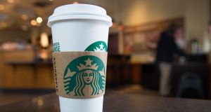 Covid-19: Starbucks temporarily banned reusable cups some days ago in response to the outbreak of coronavirus disease.  Photograph: Saul Loeb/AFP/Getty