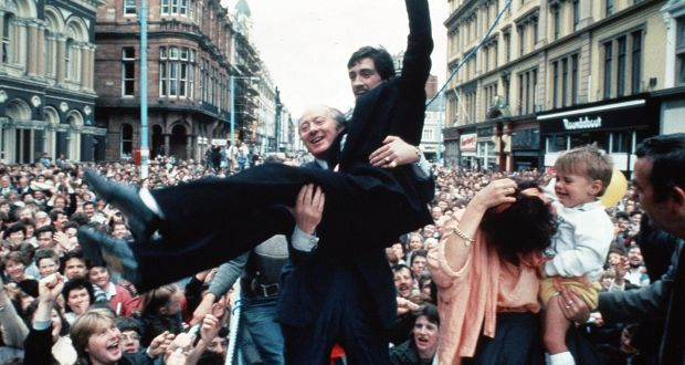 Barry McGuigan held aloft by manager Barney Eastwood on his return to Belfast – with wife Sandra and son Blain – after beating Eusebio Pedroza at Loftus Road, London, to win the WBA world featherweight title in 1985. Photograph: Pacemaker