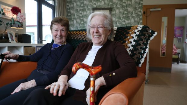 Long-time residents and best friends Joan Hechler and Mary Mernagh in the sittingroom. Photograph: Nick Bradshaw