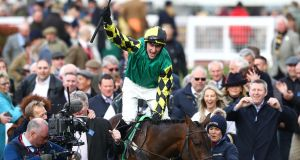 Adam Wedge riding Lisnagar Oscar celebrates winning the Paddy Power Stayers' Hurdle. Photograph: Getty Images
