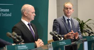 Chief Medical Officer Tony Holohan and Minister for Education Joe McHugh at the announcement of school closures at Government Buildings on Thursday. Photograph: Dara Mac Dónaill/The Irish Times